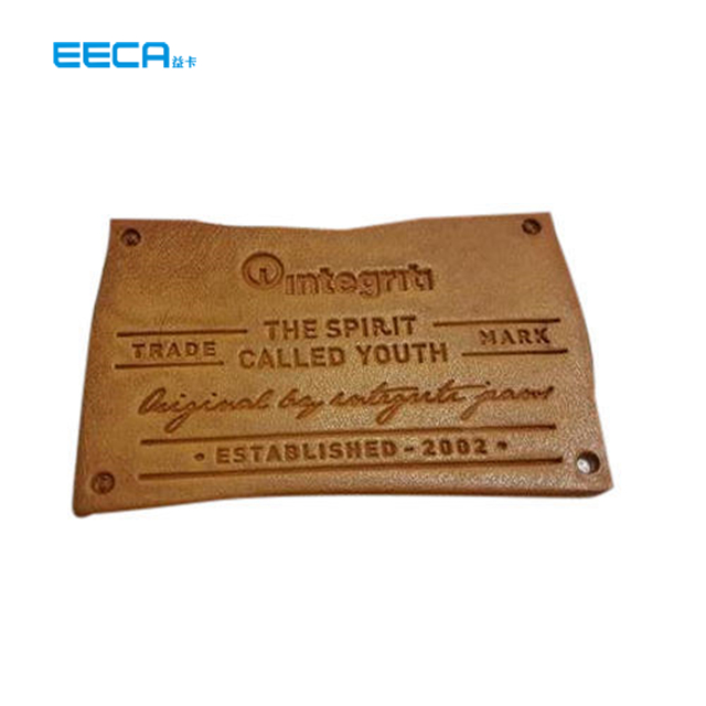 Custom creative luxury leather tag for jeans or leather coat in EECA Packaging