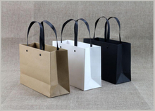 High quality black paper bag/Kraft paper bag/Handbags in EECA Packaging